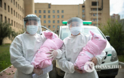Twin girls born in mid-air discharged from hospital