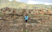 Mongolian man skywalks across Chuluut River Canyon