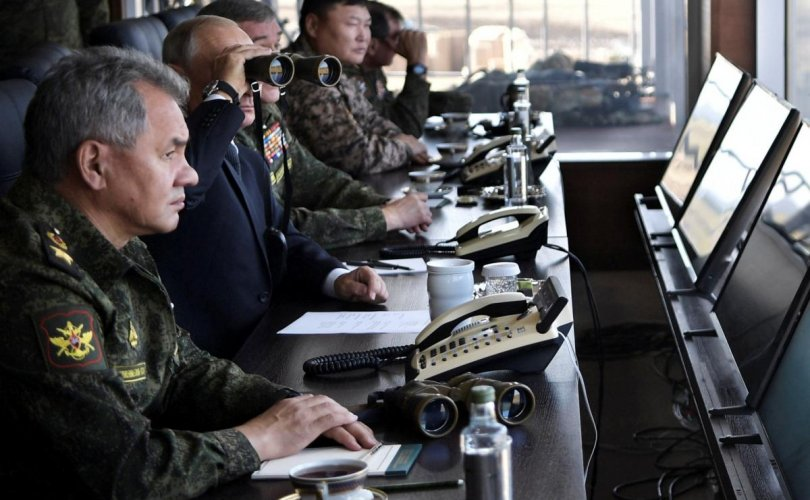 Russian President Vladimir Putin and Defence Minister Sergei Shoigu watch the Vostok-2018 war games at Tsugol military training ground in Zabaikalsky region