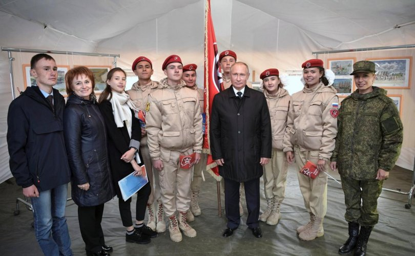 Russian President Vladimir Putin poses for a picture with the members of Yunarmiya, youth organisation associated with the defence ministry, at Tsugol military training ground in Zabaikalsky region
