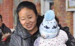 Нийт 118 хүүхэд үрчилж авсан хятад эмэгтэйд 20 жилийн ял оноов