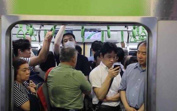 Токиогийн хагас сая гаруй хүнийг гэрээс нь ажиллуулна