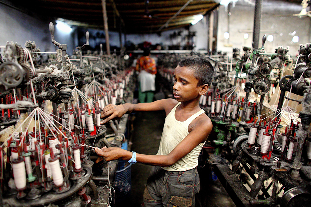 Factory machines produce an intolerable degree of echo in the working place of Sobuj (13-years-old). For adding more strain on him excessive heat works as miserable factor. Sobuj a worker of textile factory starts his day at 8am & his duty finished at 8pm
