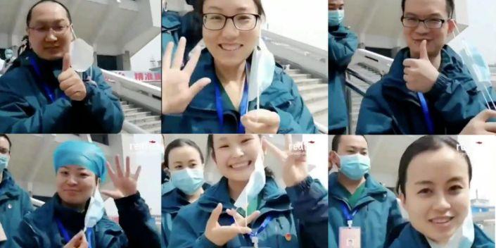 Уханий эмч нар инээмсэглэж байна