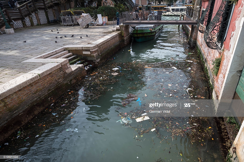 The picture shows the dirty in some of the canals of Venice, Italy
