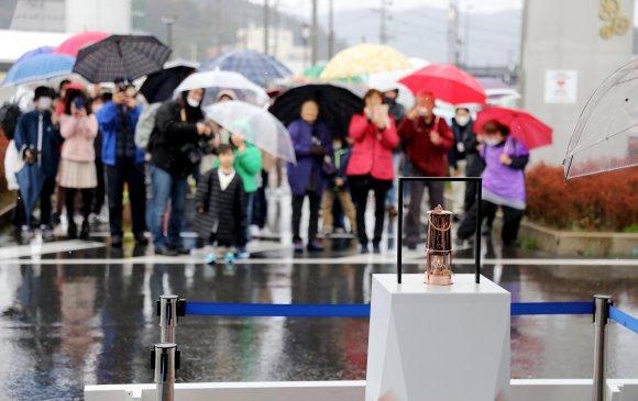 Токио-2020 олимпийн галыг нууц газар руу шилжүүлжээ