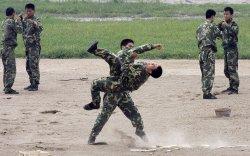 Хилийн мөргөлдөөн: БНХАУ цэргүүддээ бие хамгаалах урлаг заана