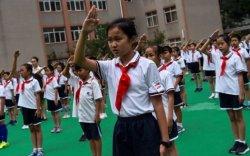 Хонгконг сургуулиуд БНХАУ-ын далбаан дор төрийн дууллыг нь дуулах ёстой