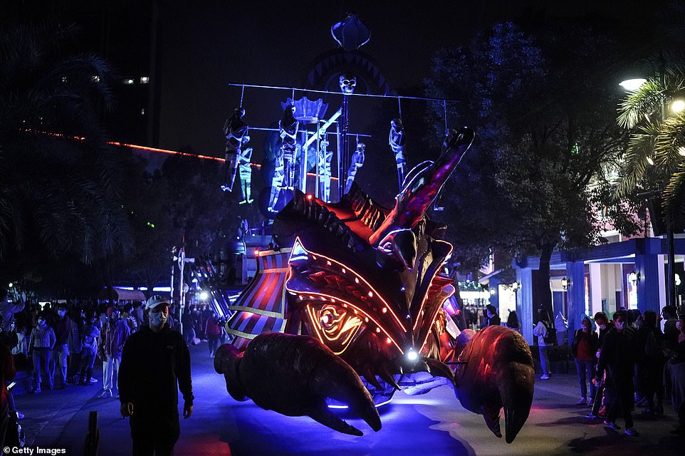 35013900-8894943-Fearsome_floats_were_a_big_feature_of_the_Halloween_parade_at_th-a-85_1604005594356