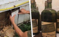 Байшингийнхаа хананаас хориотой үеийн 66 шил виски олжээ