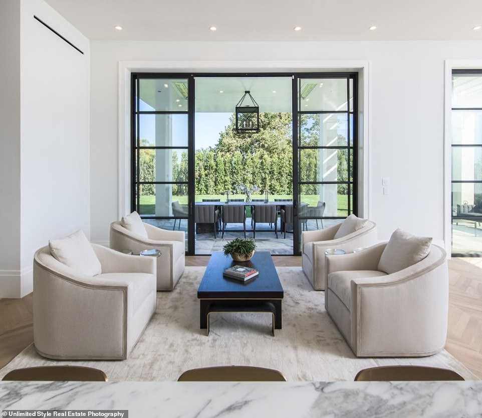 39923380-9314543-Convenient_The_home_has_a_massive_family_room_adjacent_to_its_ba-a-24_1614642030248