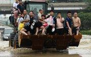 Хятадад үерийн гамшгийн дараа далайн шуурга дэгджээ