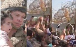 Афганчууд хүүхдээ хашаа давуулан шидэж байна