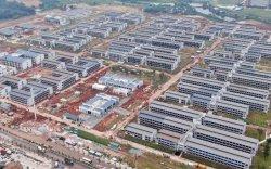 БНХАУ 5000 өрөөтэй тусгаарлах байр барьжээ